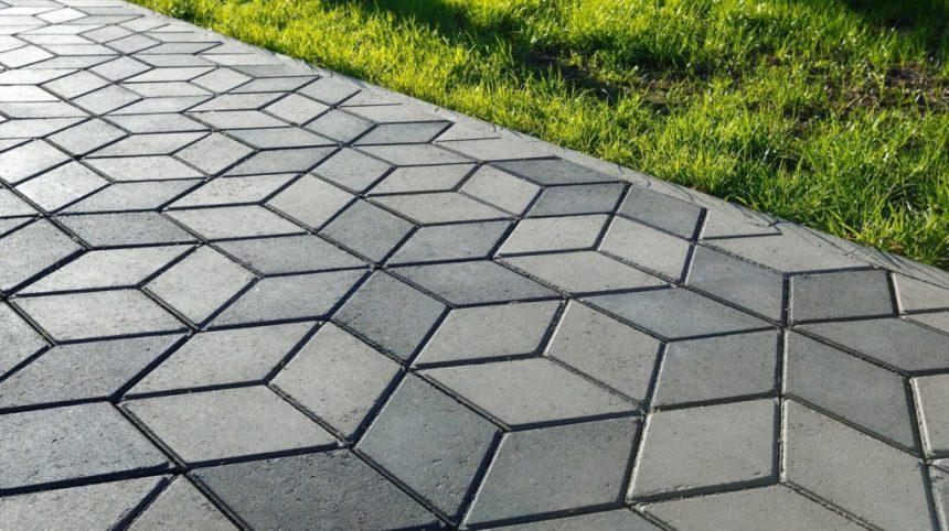 driveway paved with diamond shaped concrete pattern